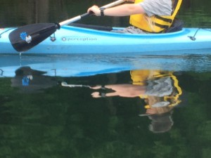 Reflections from and of a kayak.